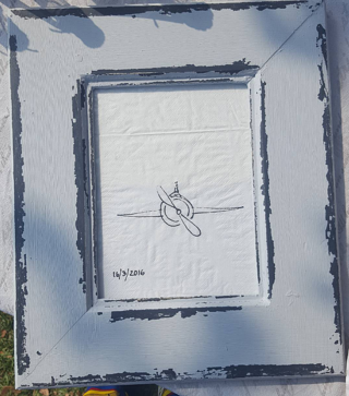 Framed copy of Spitfire Inbound's first logo on a Roco Mamas serviette