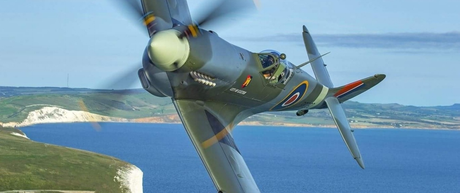 Spitfire flying over the sea